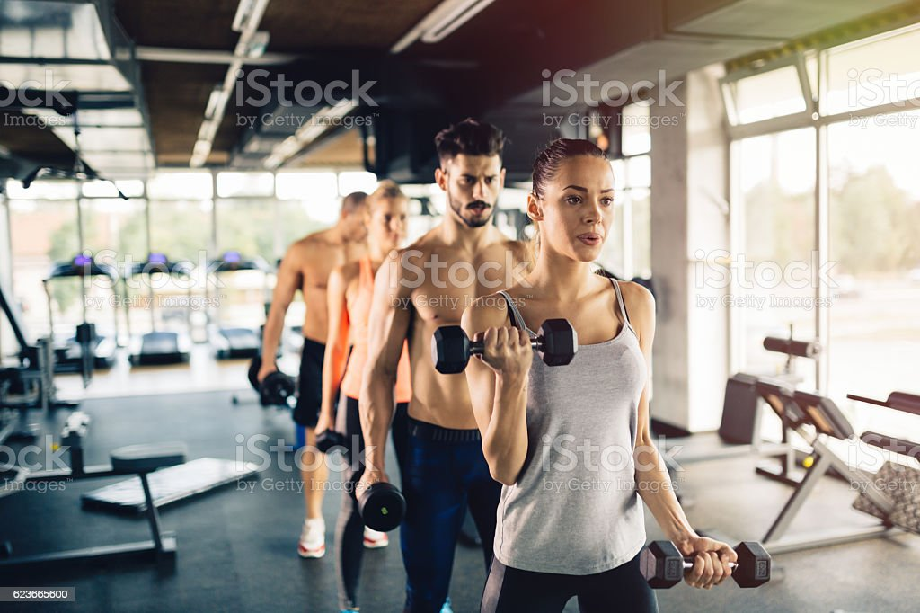 Group of people training in gym stock photo