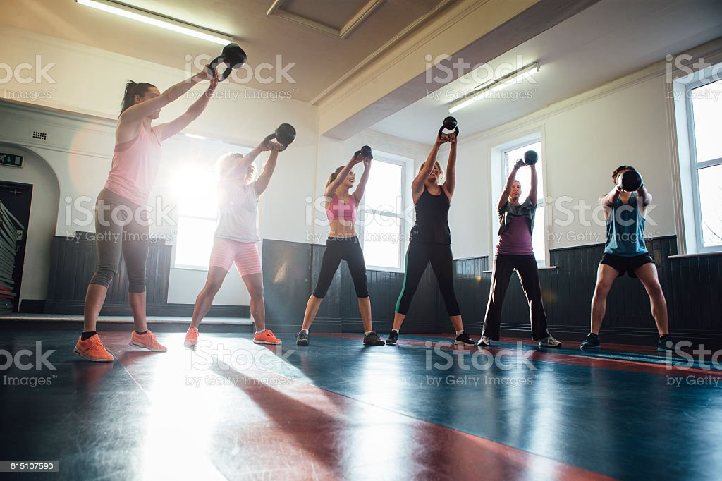 Group of People Training with Kettle Bells stock photo