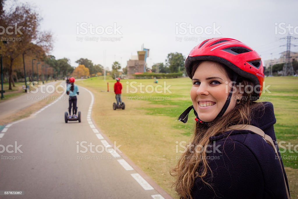 Group of people traveling on Segway in the park stock photo