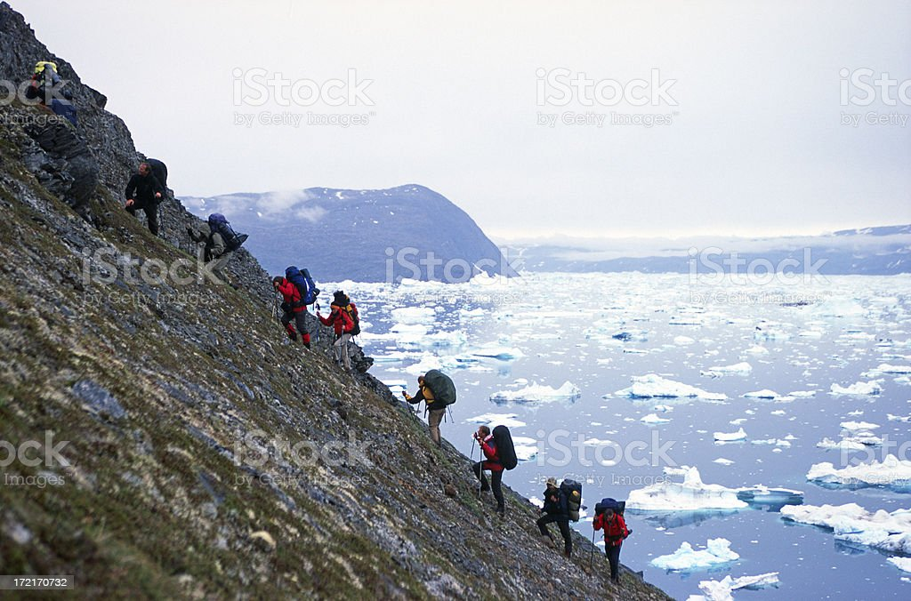 Group of people trekking in Greenland stock photo