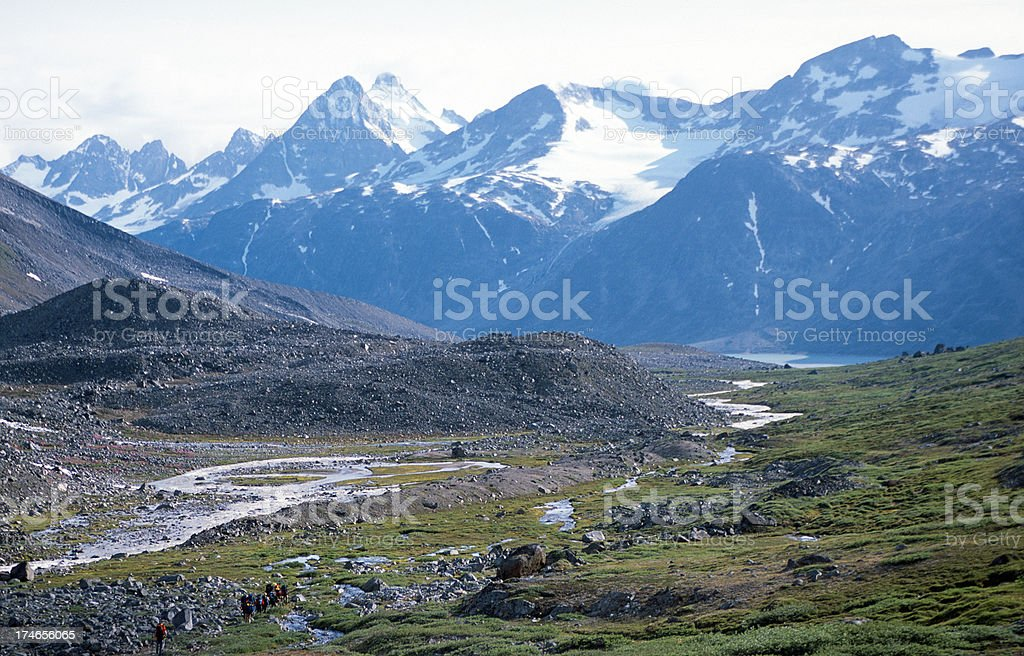 Group of people trekking in Greenland royalty-free stock photo