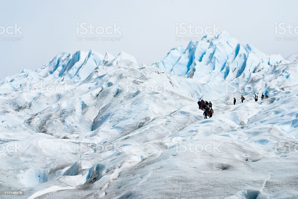 group of people trekking on the Perito Moreno Glacier (Patagonia-Argentina) stock photo