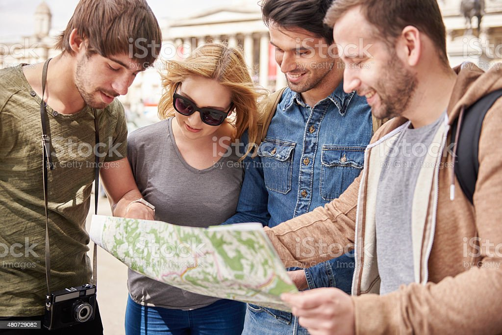 Group of people trying to find the right direction stock photo