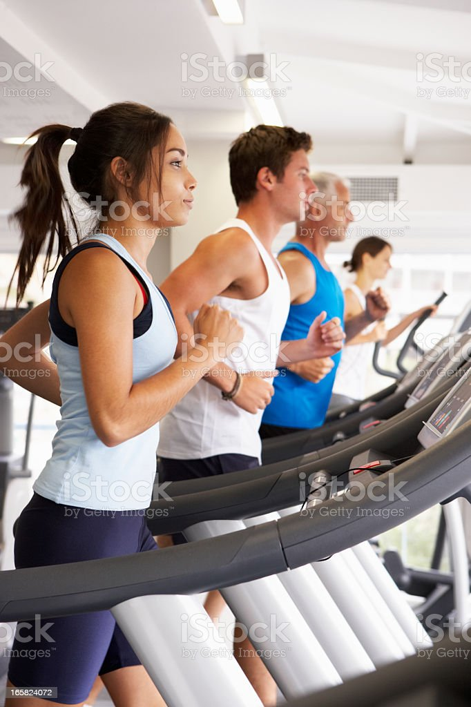 Group Of People Using Different Gym Equipment stock photo