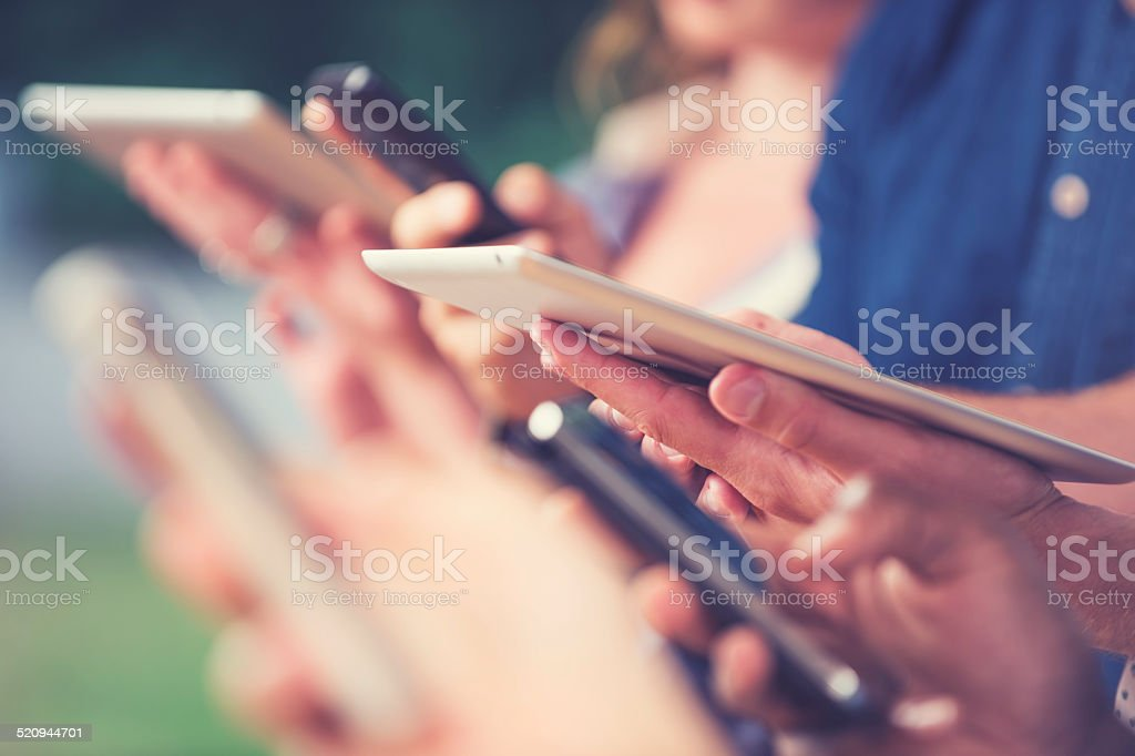 Group of people using mobile devices stock photo