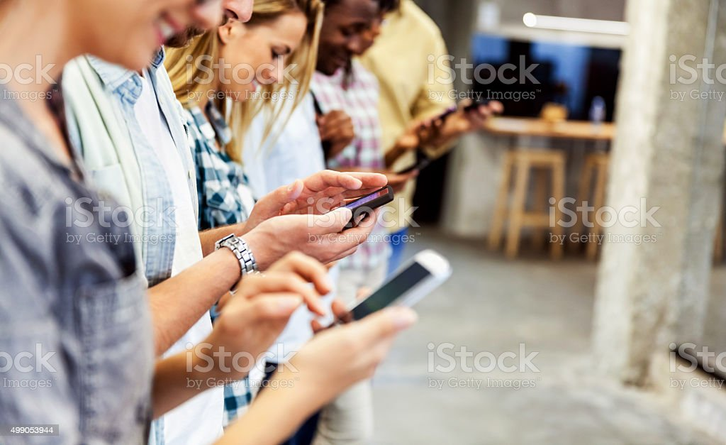 Group of people using their smart phones stock photo