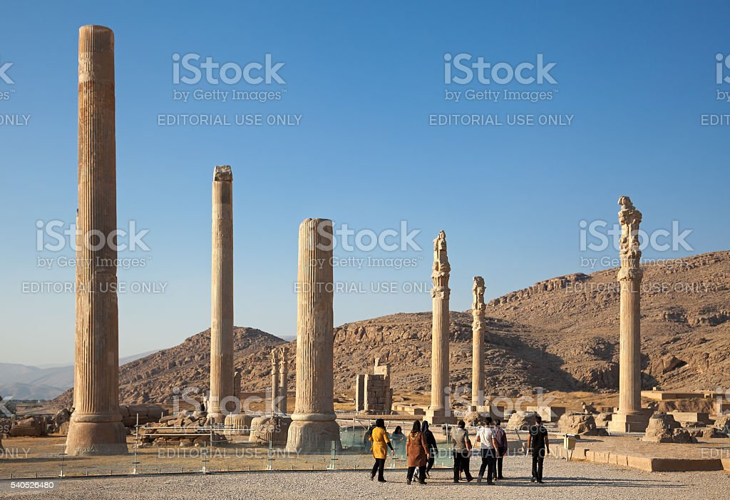 Group of People Visiting Ruins of Apadana Palace in Persepolis stock photo