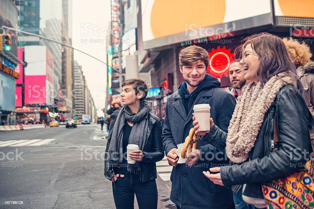 Group of people waiting at street corner in New York. stock photo