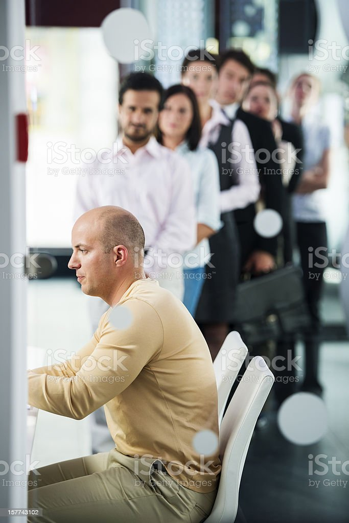 Group of People Waiting in Line royalty-free stock photo
