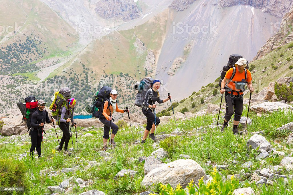 Group of people walking on trail stock photo