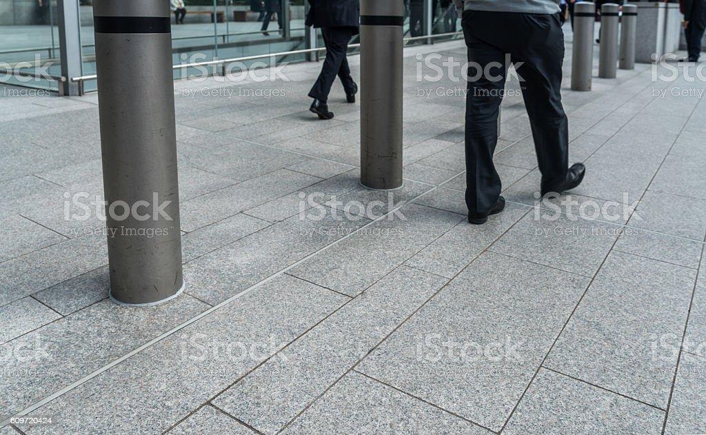 Group of People Walking On Walkway stock photo