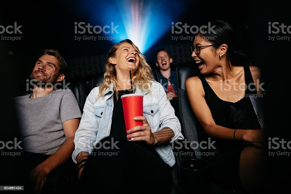 Group of people watching comedy movie in theater stock photo