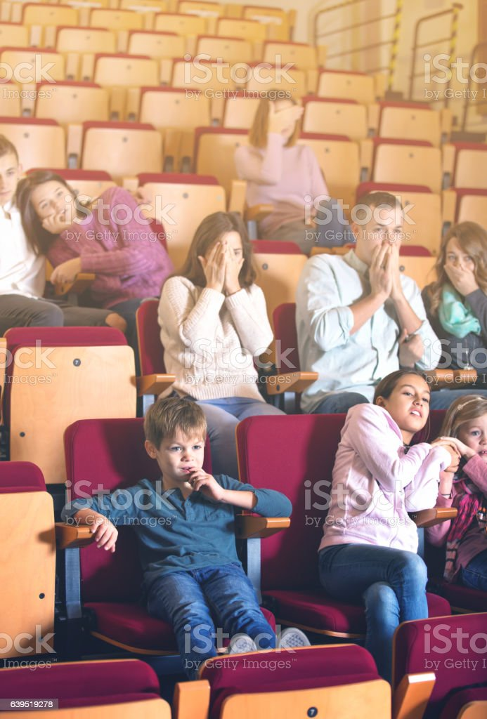 Group of people watching scary movie stock photo