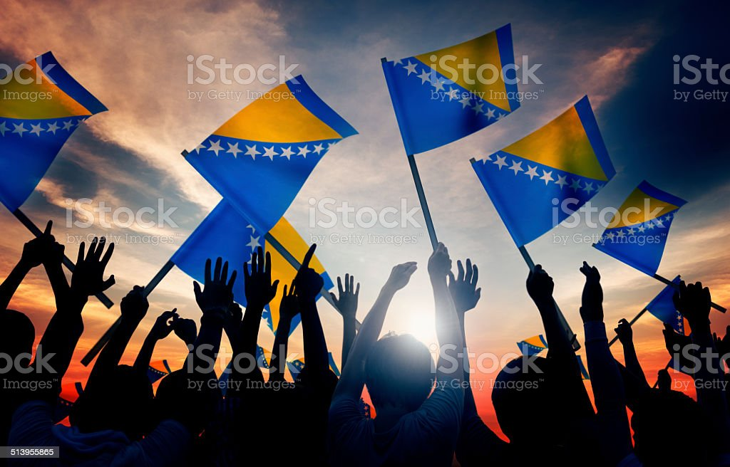 Group of People Waving the Flag of Bosnia and Hercegovina stock photo