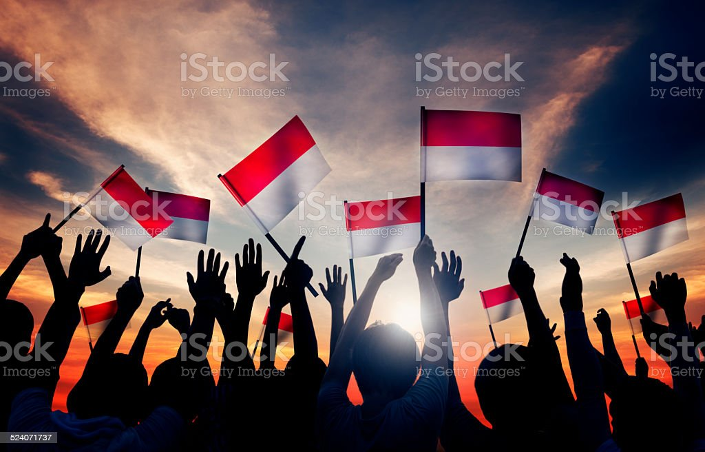 Group of People Waving the Flag of Indonesia stock photo