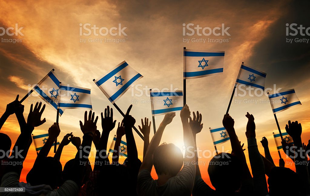 Group of People Waving the Flag of Israel stock photo