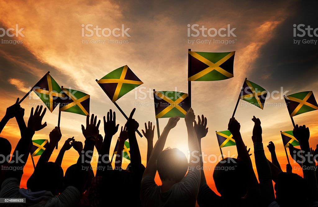 Group of People Waving the Flag of Jamaica stock photo