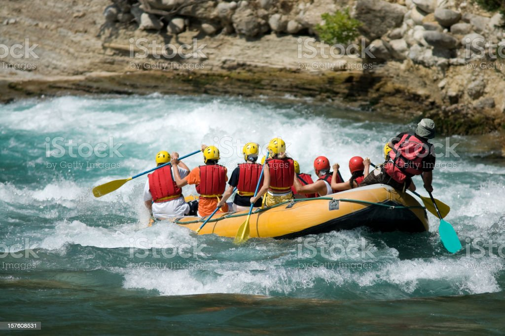 Group of people white water rafting royalty-free stock photo