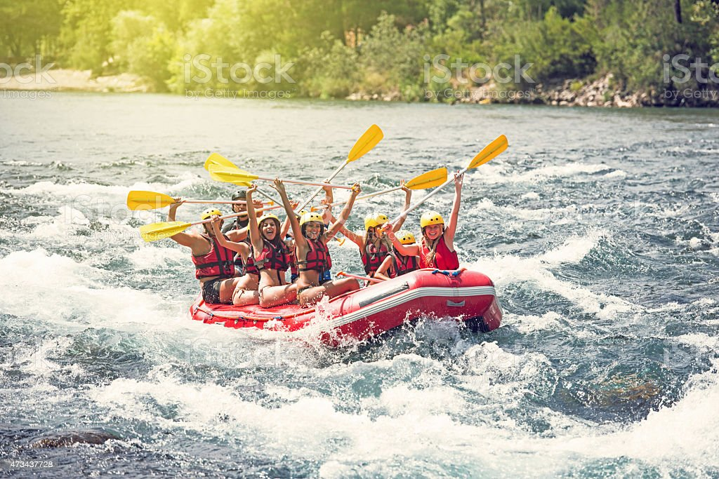 Group of people white water rafting stock photo
