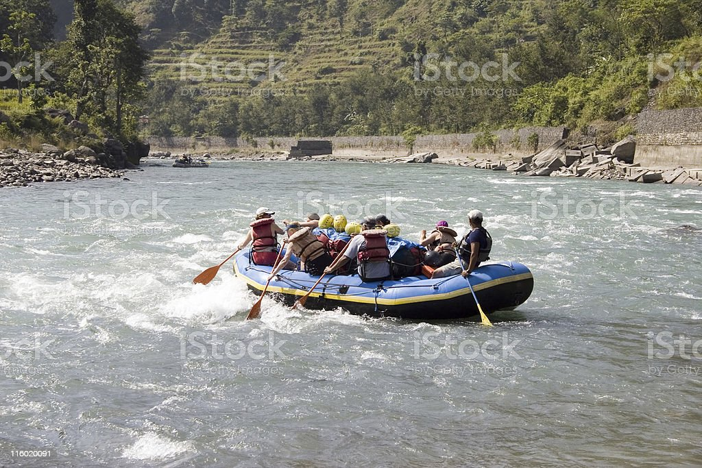 Group of people whitewater rafting in Nepal stock photo