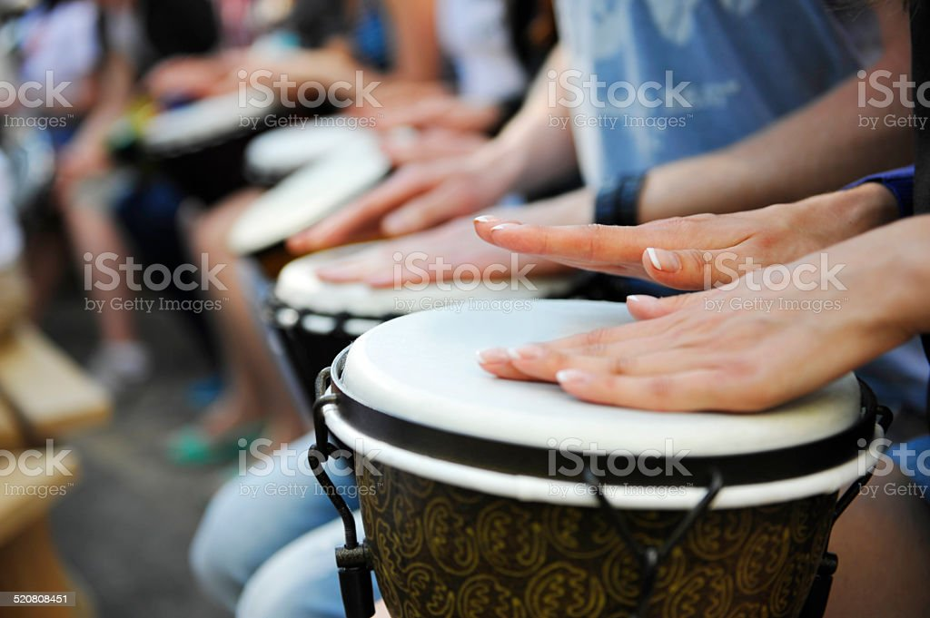 group of people with African drums stock photo