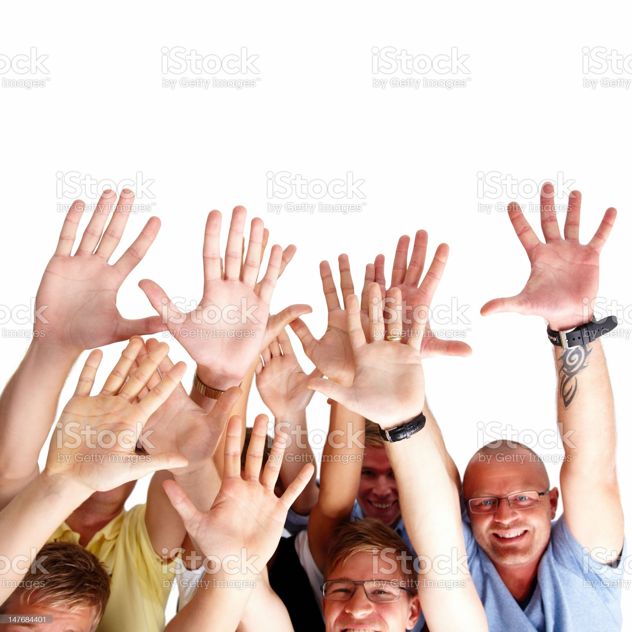 Group of people with arms raised royalty-free stock photo