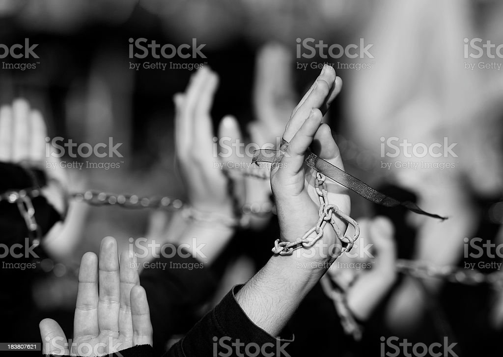 Group of people with arms raised stock photo