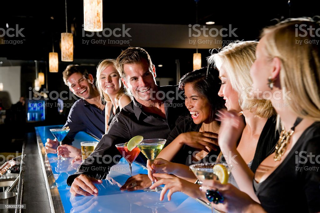 Group of people with drinks at nightclub bar royalty-free stock photo