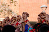 Group of people with hands up together