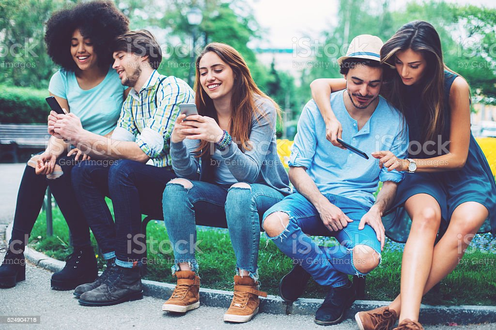 Group of people with smart phones stock photo