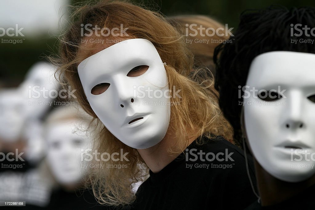 Group of people with white masks looking into camera royalty-free stock photo