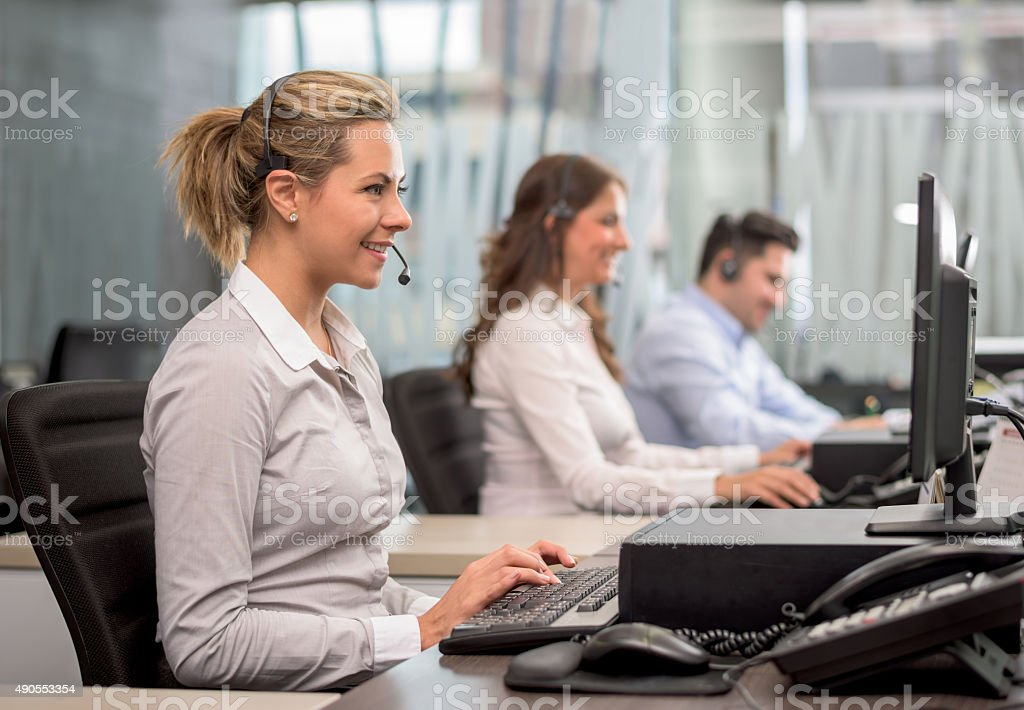 Group of people working at a call center stock photo