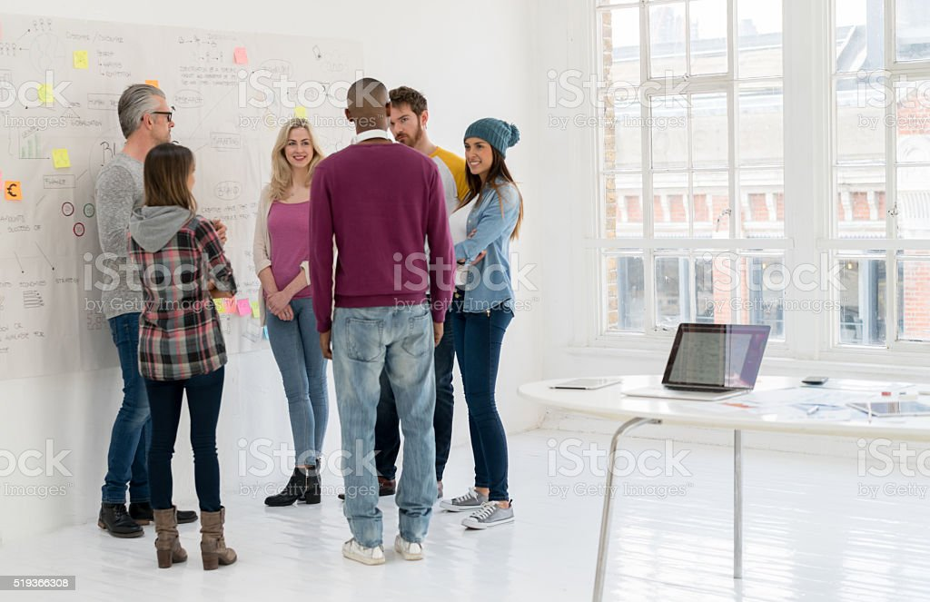 Group of people working at a creative office stock photo