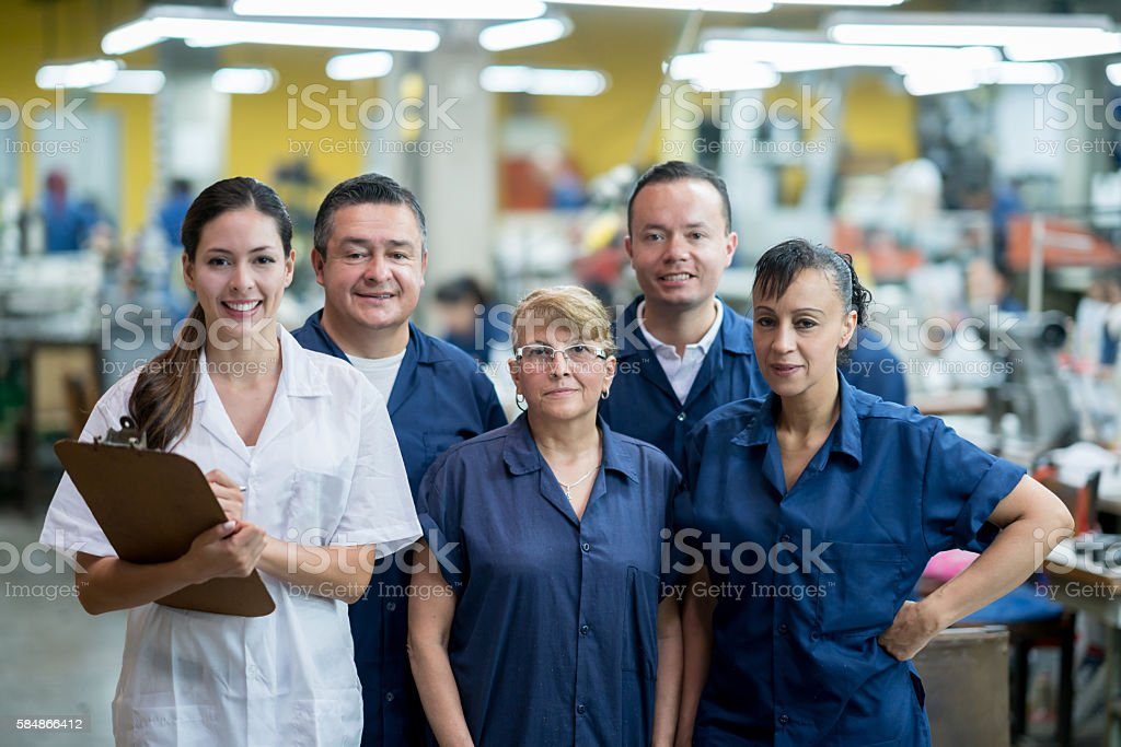 Group of people working at a factory stock photo