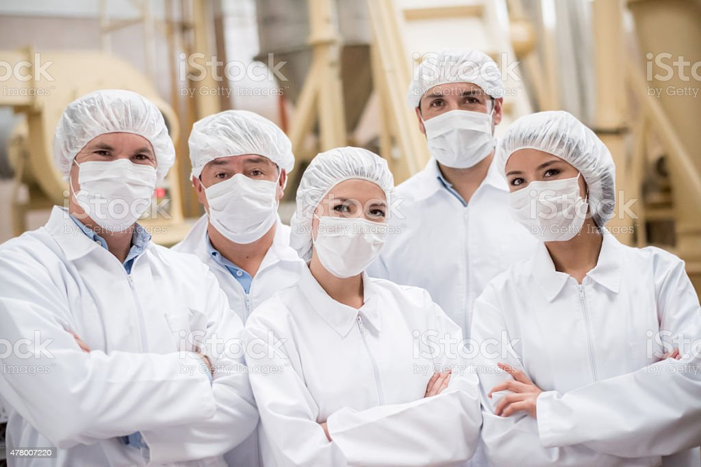 Group of people working at a food factory stock photo