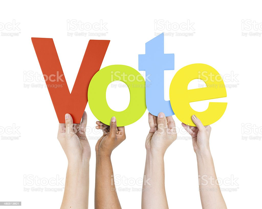 Group of People's Hands Holding Word Vote stock photo