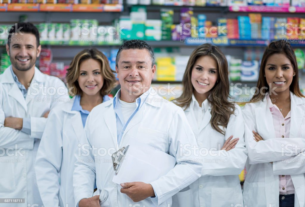 Group of pharmacists at the drugstore stock photo