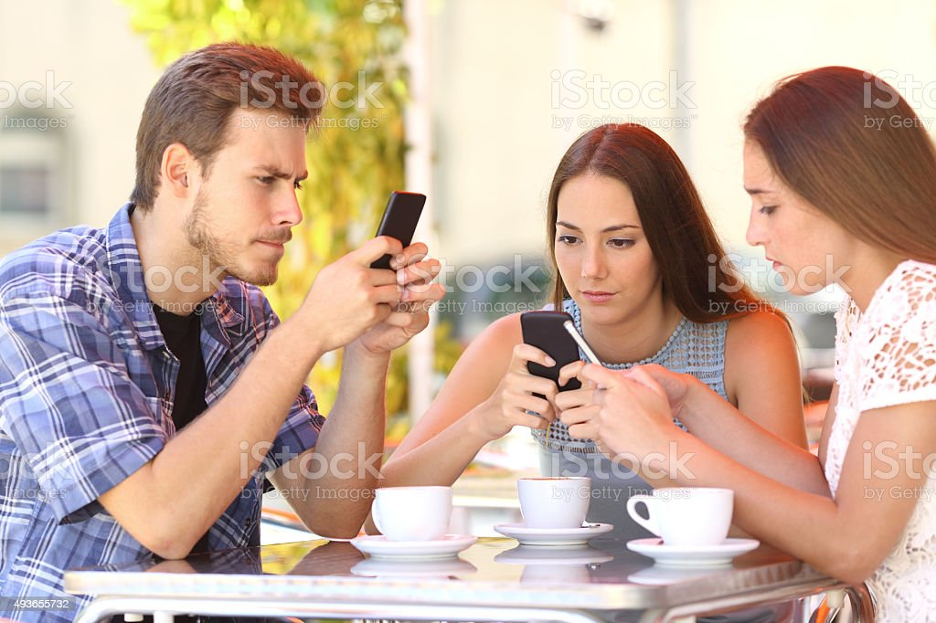Group of phone addicted friends in a coffee shop stock photo