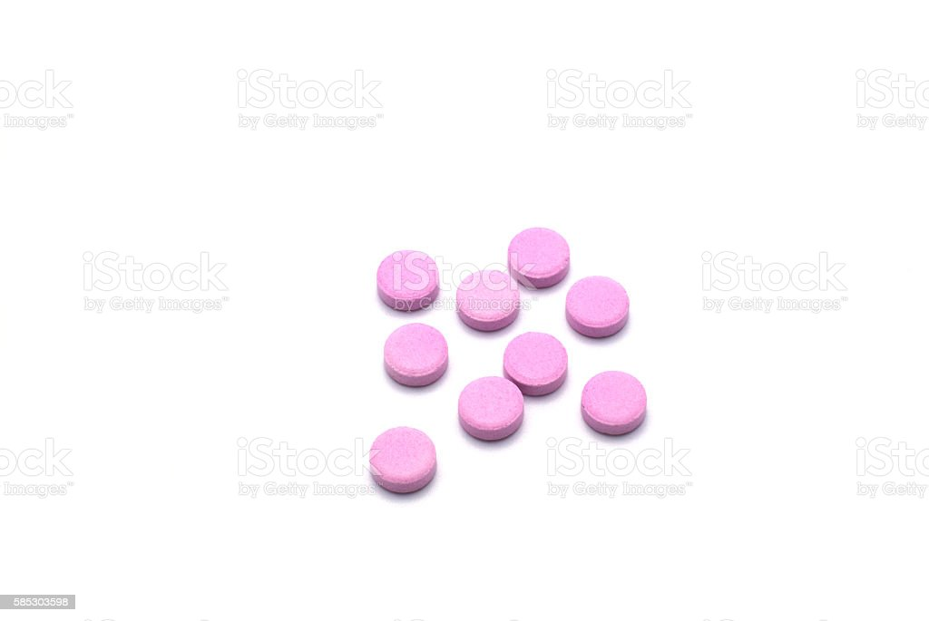Group of pink pills isolated on white background. stock photo