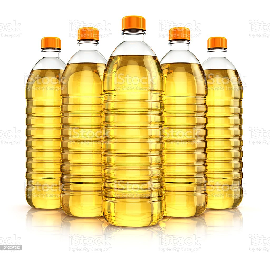 Group of plastic bottles with vegetable cooking oil stock photo
