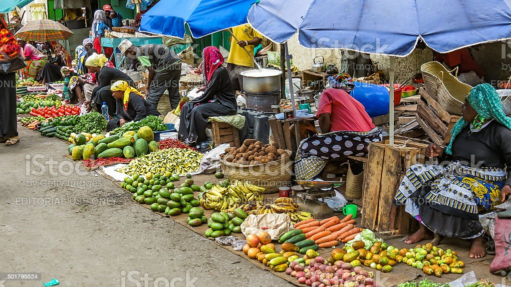 Group of poor women selling vegetables and fruits stock photo