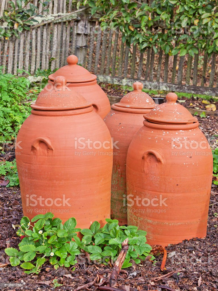 Group of pots traditionally used for growing rhubarb UK stock photo