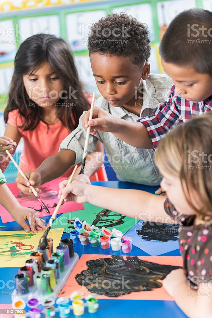 Group of preschoolers in art class painting pictures stock photo