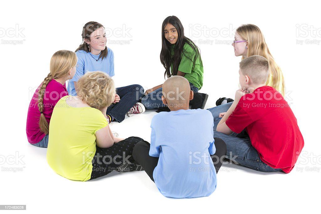 Group of pre-teens children talking a circle on white royalty-free stock photo