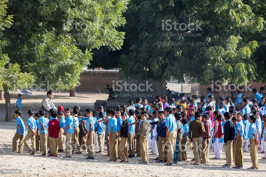 Group of primary school students on schoolyard, Rajasthan, India stock photo