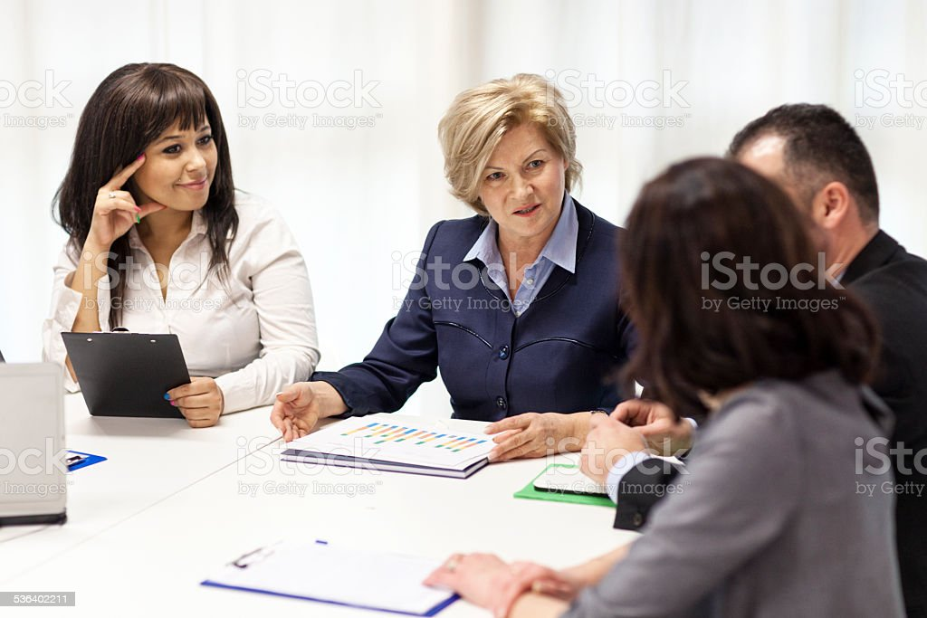 Group Of Professionals At Business Meeting stock photo