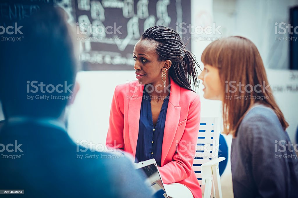 Group of  professionals in business meeting stock photo