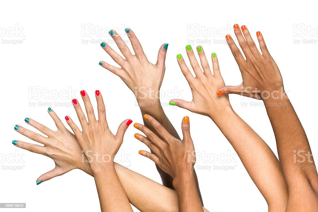 Group of raised multiethnics female hands with colored manicure royalty-free stock photo
