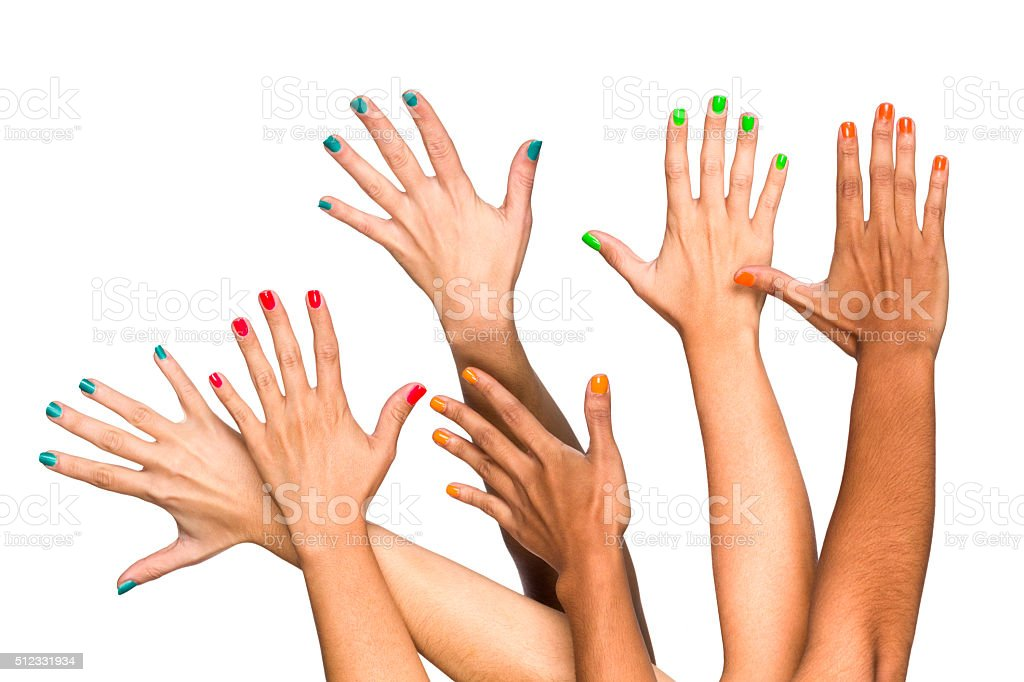 Group of raised multiethnics female hands with colored manicure stock photo