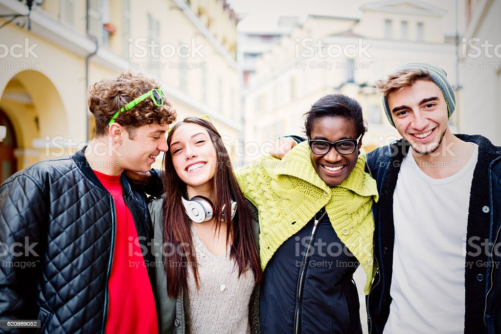 Group of real mixed race friends stock photo